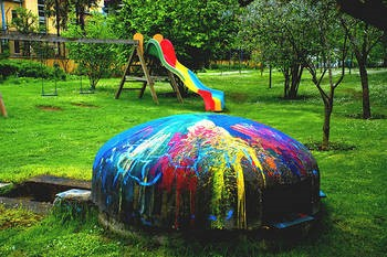 A bunker, recolored and repurposed, as part of a playground.