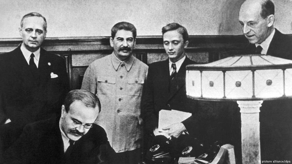 Vyacheslav Molotov signs the Molotov-Ribbentrop Pact.