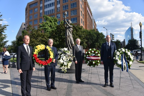 Diplomatic Representatives of the Baltic Nations pose in front of wreaths lain to commemorate the Baltic victims of communism and Nazism.