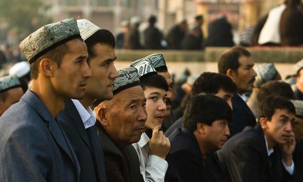Uyghur Men Praying.jpeg