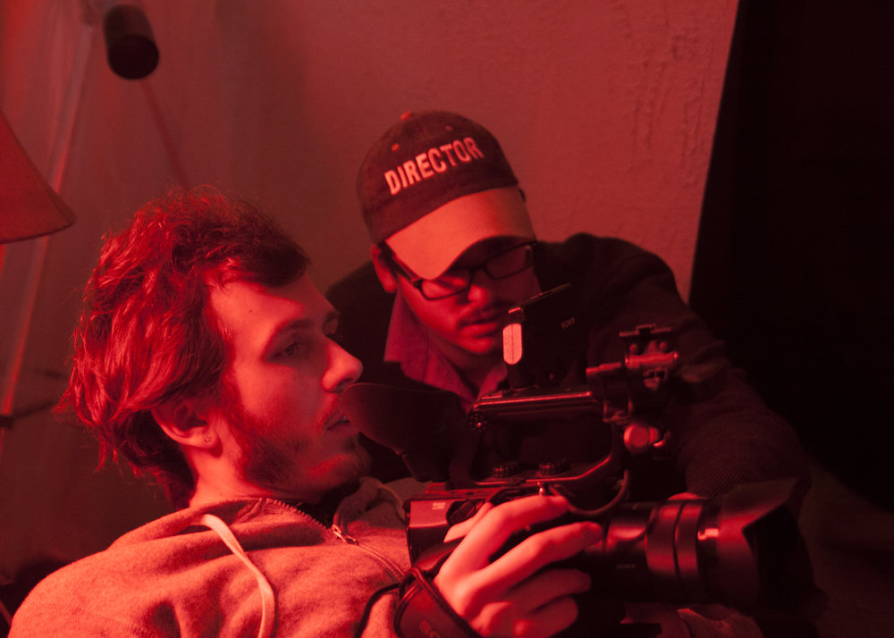Ty Higgs prepares the camera with Director R.J. Maurer looking on.