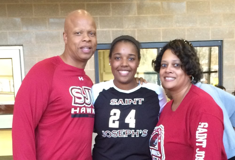 Nia and parents at St Joes.JPG