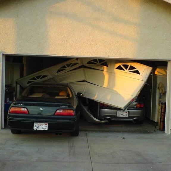 Door in the Open Position & After a Crash Into the Garage Door u2014 Quality Overhead Door