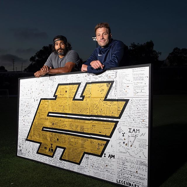 "Sat down with my good friend @yogiroth for his  #LifeWithoutLimits Podcast. We had a great conversation around Love, Fear, art and my overall inspiration.  We also dug into what we did at the 2018 @elite11 Quarterback camp revolving about the topic of ""I Am"" (Link is in my bio) ⠀⠀⠀⠀⠀⠀⠀⠀⠀ Ruben Rojas is an international street artist whose art has impacted the world through powerful and simple messages that revolve around the idea of love. He joined Yogi Roth on the LIFE WITHOUT LIMITS podcast to share his transition into the art community from finance and how his art has impacted the top high school quarterbacks in the nation at the 2018 Elite 11 Quarterback competition. The 2018 theme for the Elite 11 was #iAm. The focus of Yogi, the host of the Elite 11, and the staff was to remind the high profile student-athletes that they are more than just quarterbacks. Ruben guided that conversation with his street art, as each athlete created a canvas that had their #iAm statement written on it. Ruben then combined each canvas into a mural that celebrated the journey of each QB and the 2018 Elite 11 class. It is titled, 'I Am. We Are.' His conversation with Yogi will have you thinking about your path, offer you tools to seek your best self and inspire you, as Ruben says 'nothing is impossible unless we say it is.' To see Ruben's art be sure to watch the Elite 11 documentary series later this summer on NFL Network and other digital platforms. Follow Ruben @RubenRojas or visit him at www.RubenRojas.com. For more #LifeWithoutLimits conversations visit www.YogiRoth.com or follow Yogi on Twitter @YogiRoth. ⠀⠀⠀⠀⠀⠀⠀⠀⠀ #rubenrojas #yogiroth #podcast #nikefootball #elite11 #streetart #interview #podcasts #speaker #motivation #inspiration #bethechange #iam"