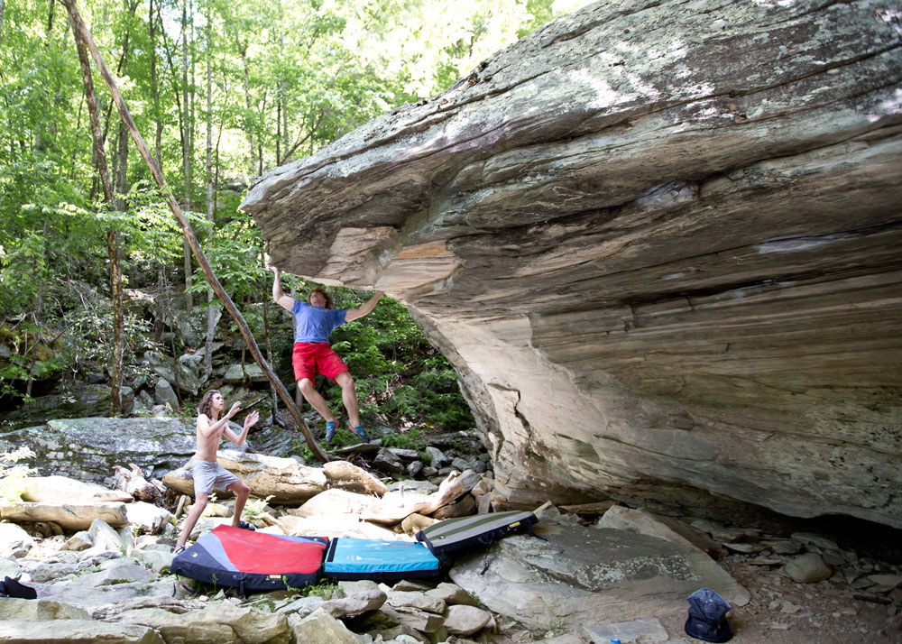 Nick Hodder making big moves on the Linville Gorge river boulders. Photo by Mackenzie Taylor Perry.