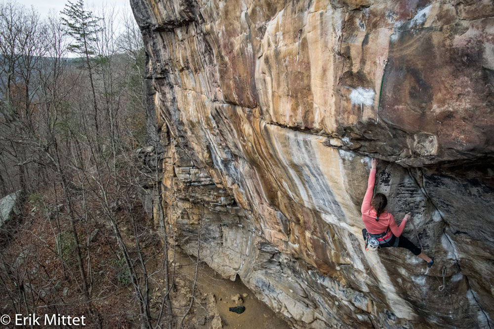 The author clipping a draw on  Proper Soul  after finishing the 2-bolt dihedral crux. Photo by Erik Mittet.