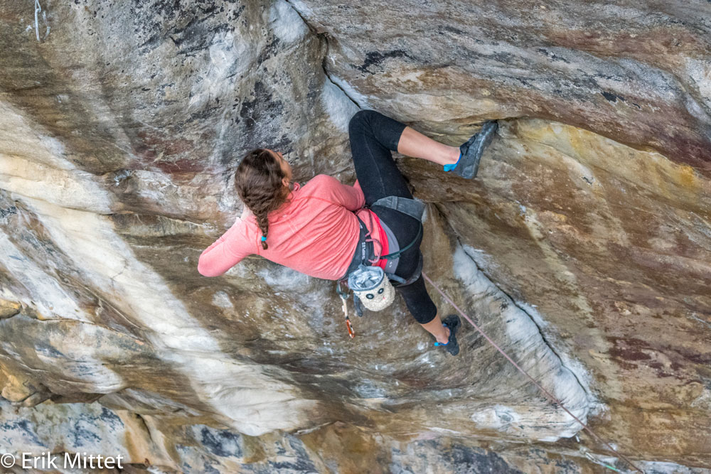 Kerry working the knee-scum in the middle of the dihedral crux of  Proper Soul . Photo by Erik Mittet.