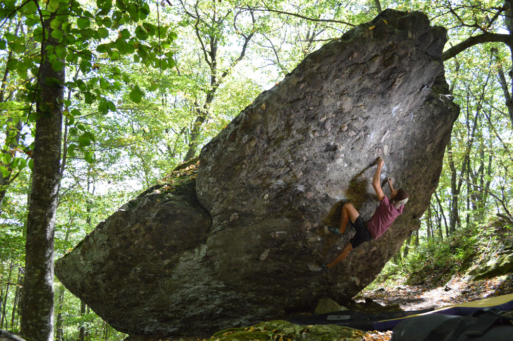 Hidden beneath thick vegetation in the Virginia mountains, the Grayson Highlands AVP Boulders are perfect for summer bouldering sessions. Photo by Aaron Parlier.