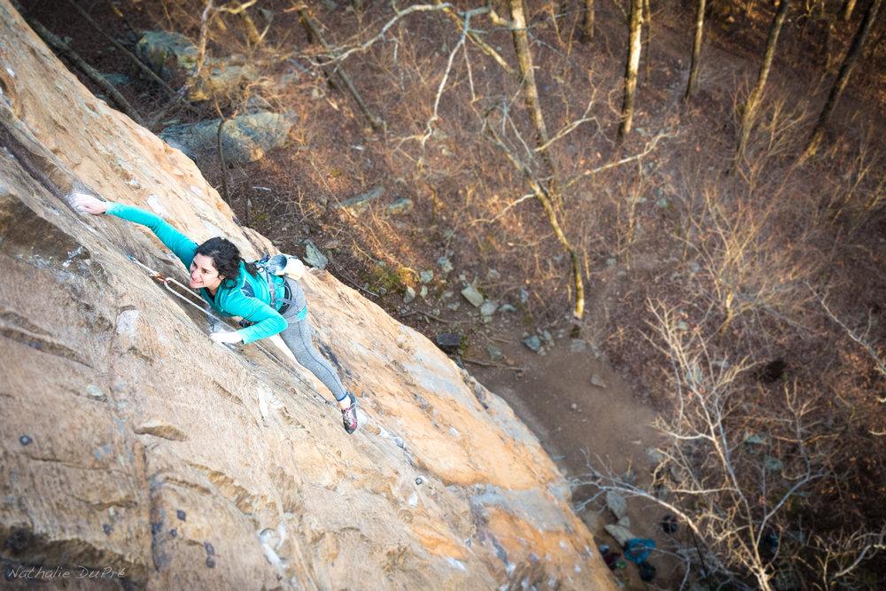 SCC Stewardship Director Angie Langevin climbing  Predator  at Castle Rock. Photo by  Nathalie DuPre .