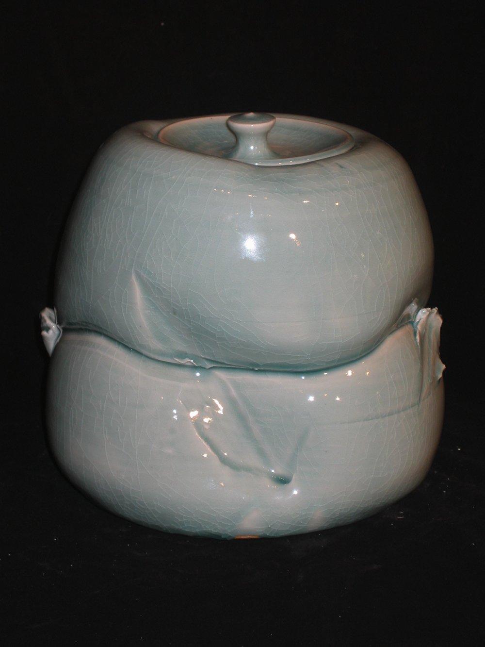 Porcelain Elephant Foot Covered Jar Form.jpg