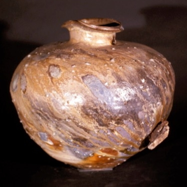 wood-fired jar with attached support