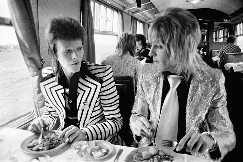 Mick Rock  Bowie Ronson Lunch on Train to Aberdeen, UK 1973 (30 X 40)  Silver gelatin limited edition photographic print on paper  38 x 49 1/2 (framed)  Email us for all inquiries: gerard@robertkiddgallery.com
