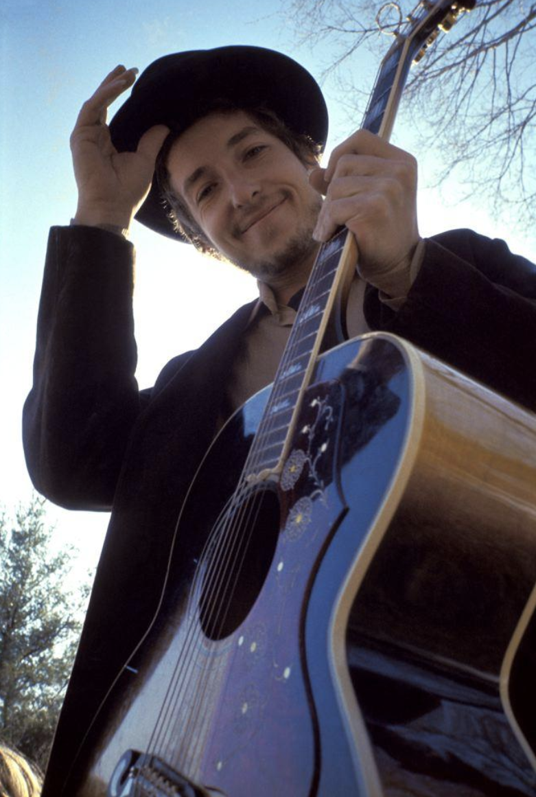 Elliot Landy  335 - Bob Dylan - Nashville Skyline  At his Byrdcliffe home, Nashville Skyline album cover, Woodstock, NY, 1969.  Silver gelatin limited edition photographic print  Email us for all inquiries: gerard@robertkiddgallery.com