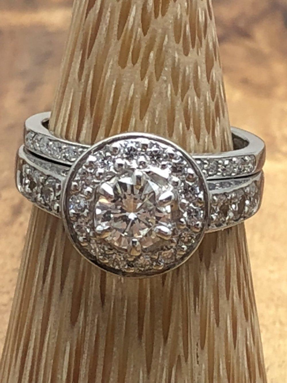 Round cut Diamond Engagement and wedder.JPG