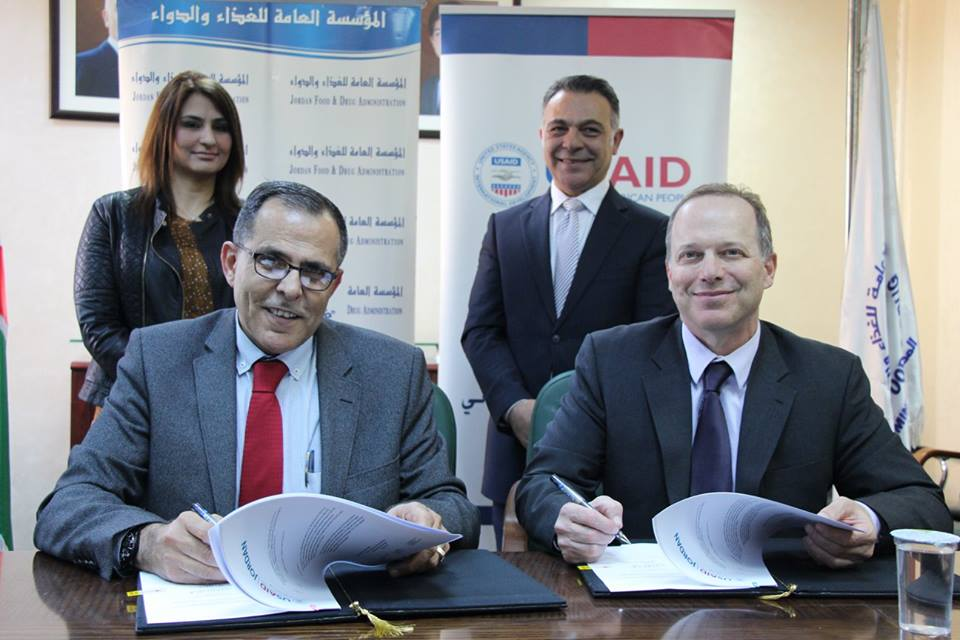 Front: JFDA Director, Dr. Hayel Obeidat, and USAID Mission Director, Dr. Jim Barnhart Back: JFDA's Head of Drug Directorate, Dr. Wesal Haqaish, and USAID JCP Chief of Party, Dr. Wissam Rabadi