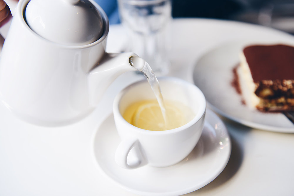 TRADITIONAL HIGH TEA $42 per person - An exquisite selection of 12 housemade petite sweet treats and savoury delights, plus signature scones with fresh cream and jam and artisan tea or specialty coffee.
