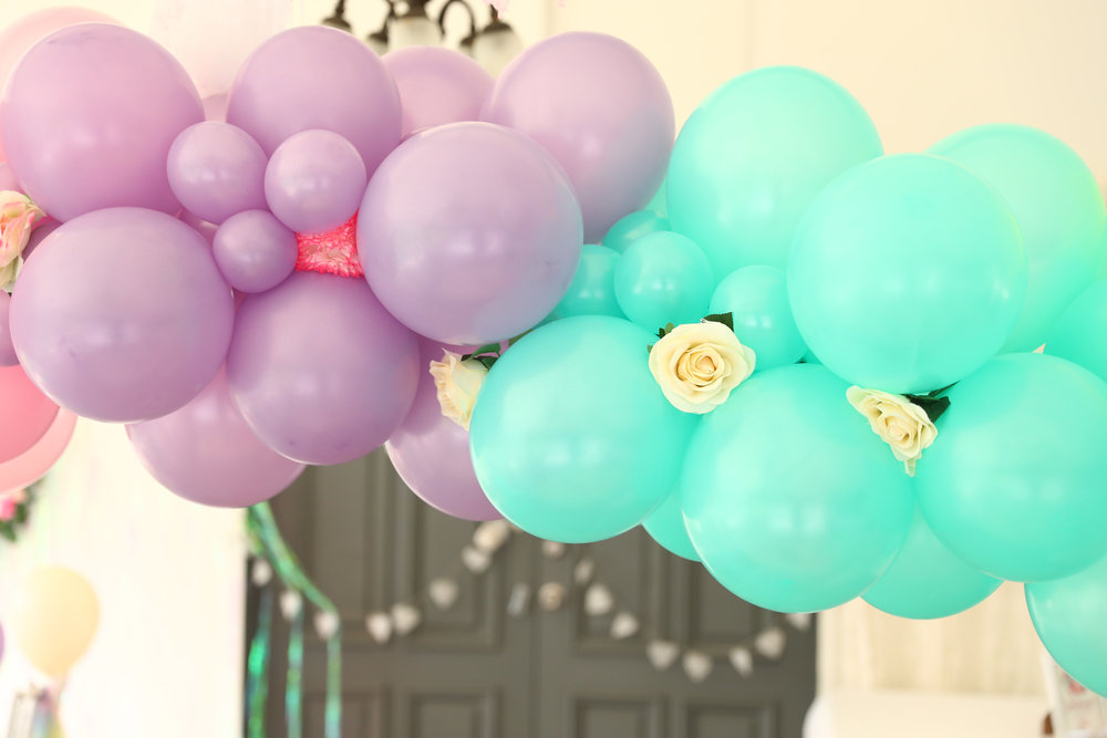 STYLED BALLOONS - Complement your party theme with beautiful balloon decorations, ranging from simple yet stunning to show-stopping. Helium balloon arrangements can be delivered and installed to bring added pizzazz to your event. Also available - single helium balloons tied to each chair for guests then take home, or a deluxe and on-trend balloon garland.
