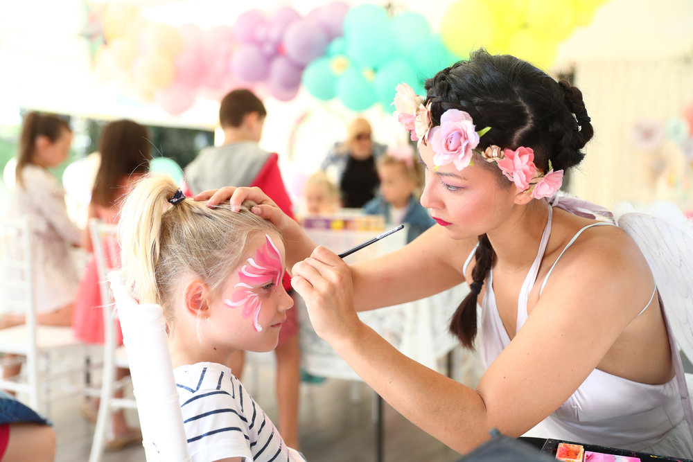 FACE PAINTING $70/hour. - Face painting is always a winning addition to your party! Our hand-picked friendly and professional face painters use only top-quality, hypoallergenic products to create colour magic as they adorn young guests in stunning designs including artistic unicorns and so much more! Package can include glitter tattoos. (last 2-5 days).