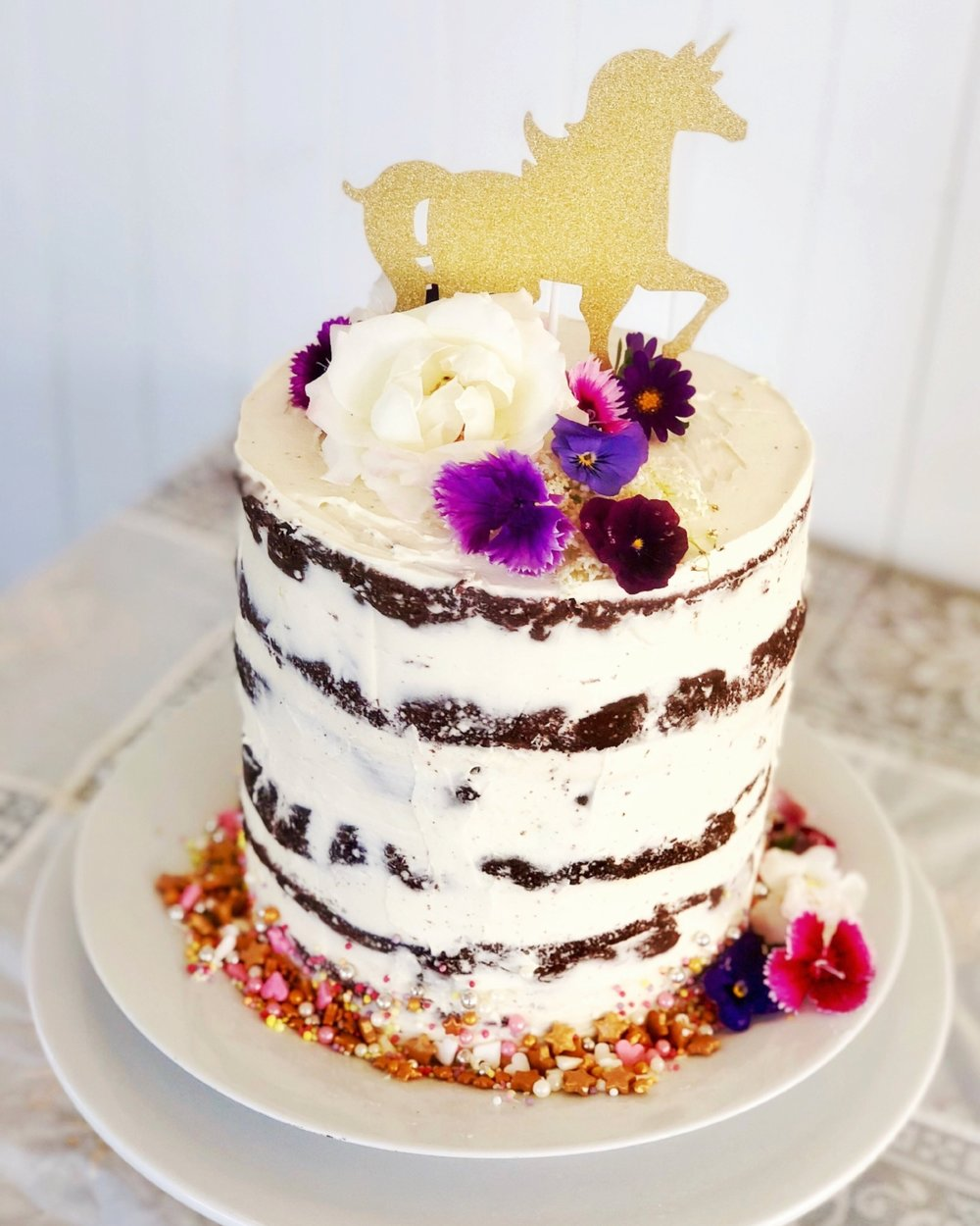 CELEBRATION CAKE $100/ serves up to 30 - Our chef can customise a beautiful semi-naked style celebration cake adorned with fresh flowers to provide a decadent finale to your child's party.