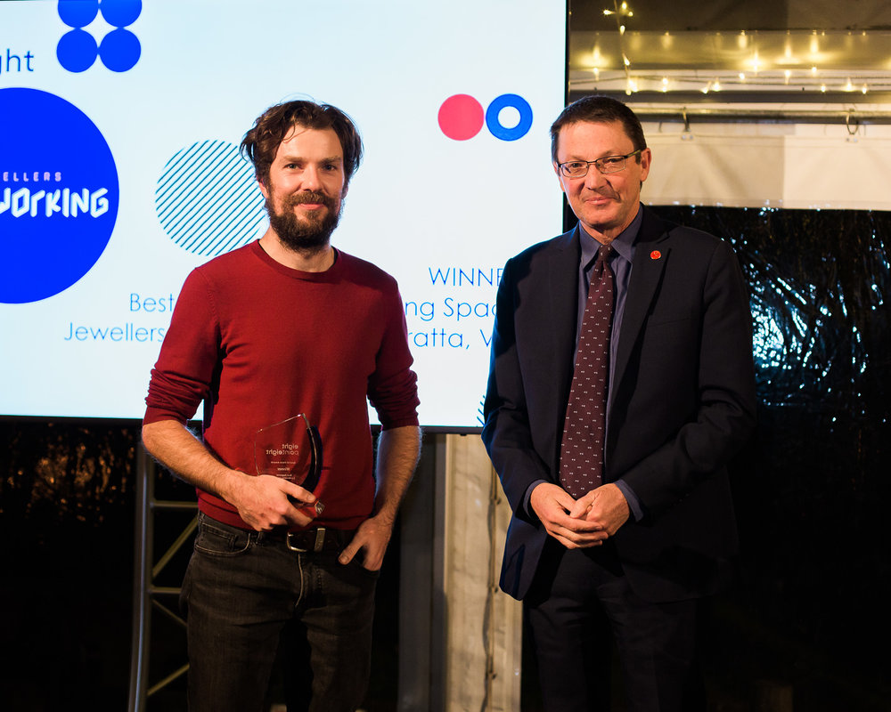 Scot McDonald MC Parliamentary Secretary for Planning, Central Coast and the Hunter presents the 8point8 Wave Award to Rohan Latimer of Jewellers Coworking.