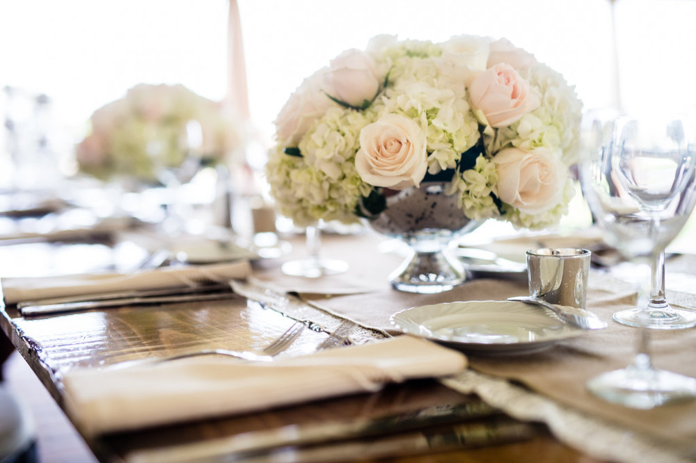 The burlap and lace table runners looked gorgeous on the farmhouse tables and with the centerpieces.
