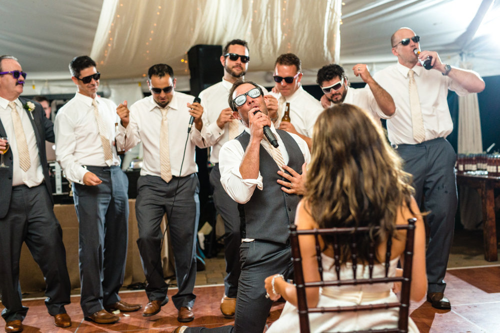 Ryan and his groomsmen serenading the bride!