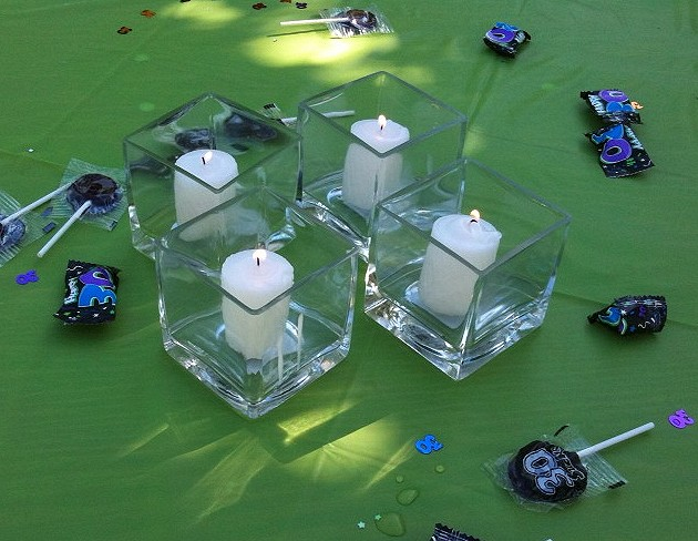 We used square votives on the tables as well as some other decorations.