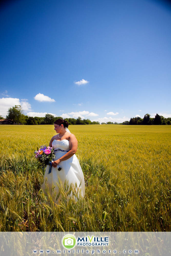 I just love this picture of Jenn in the wheat field! The photog actually made the whole bridal party get in and got some great pictures out of it.
