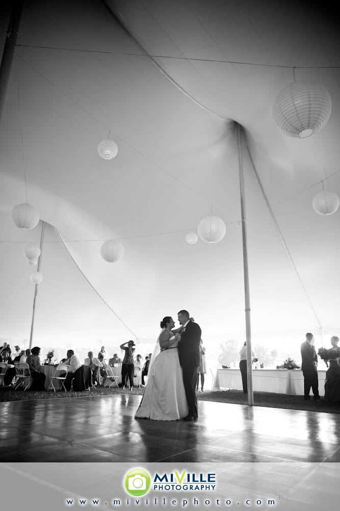 First dance as husband and wife. Note the awesome lights in the tent! This picture doesn't do them justice.