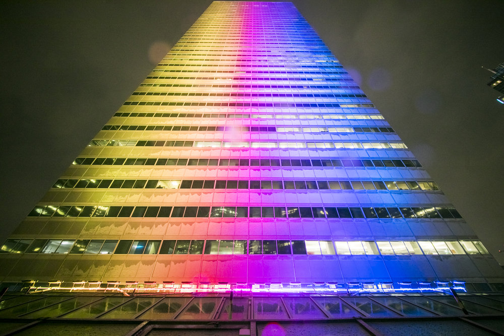 BOSTON MAGAZINE - PORT LIGHTING SYSTEMS SPLASHES CITY SKYSCRAPERS WITH COLOR November 2018 - Last year around this time, One Financial Center looked like many of its neighboring skyscrapers at nightfall: fairly unremarkable. But now, take a stroll in through Financial District after sunset, and you'll notice the building's facade glows bright pink, blue, green, yellow, and sometimes rainbow.While projecting light onto a building isn't exactly newfangled technology, One Financial Center is the first full-face, color-changing skyscraper in Boston. The city, it seems, has been slow to catch on to installing architectural light shows on a large scale…
