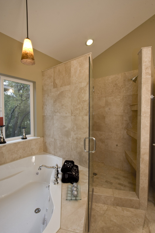 19 Spacious Travertine Master Shower.jpg