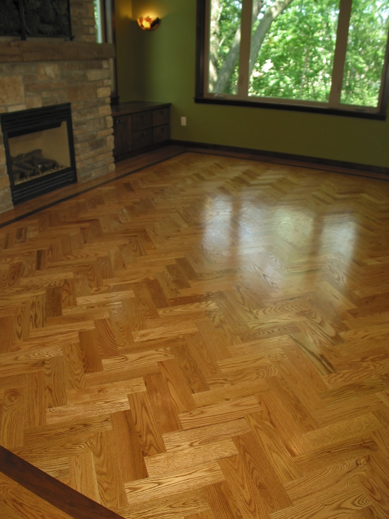 19 Enjoy the Character of Herringbone Laid Oak Floors with Walnut Feature Strip.JPG