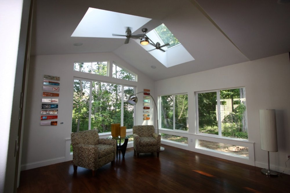 43 Glorious Sunroom with Hardwood Floors.jpg