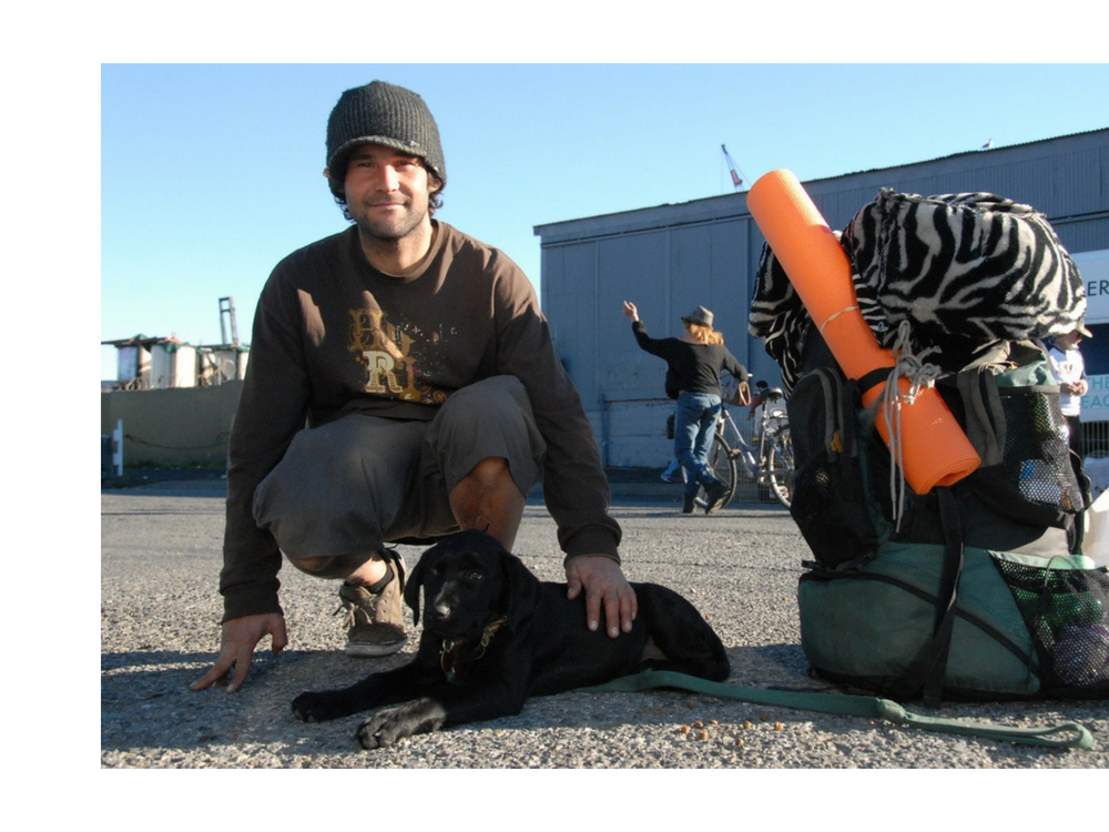 Al and Trinity - Al and his puppy, Trinity, relax after they each received services at January's SOS/VET SOS dual clinic. Originally from Ventura, Al is now traveling around the West Coast and currently living outdoors in San Francisco. If it weren't for SOS and VET SOS, Al says he doesn't know where he would get care for himself or Trinity. With us, he was able to receive all the medical  and veterinary services he needed in one place.