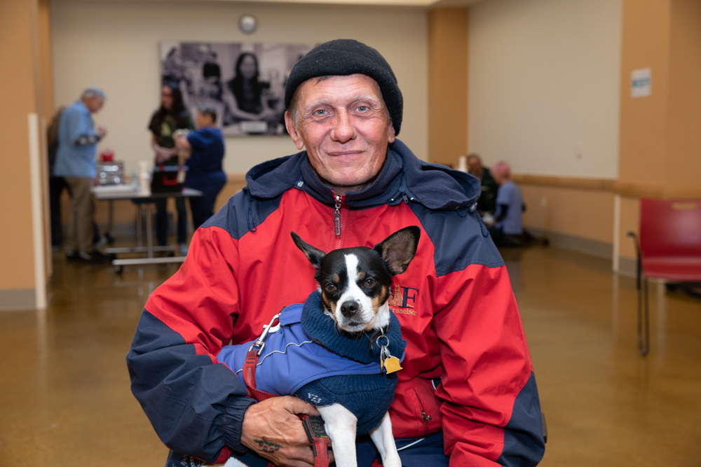 "Richard and Toodles - Richard and his partner, James, found Toodles in an abandoned car after talking with a psychic and wishing for a dog. Richard says, ""Toodles helps keep my family together while we've been homeless. He's a godsend for us."""