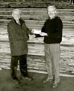 Harry hands over another cheque to Woodland Heritage co-founder, Peter Goodwin.