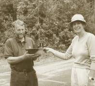 Sally Goodwin presents Ian Fletcher with a walnut bowl at Cragside