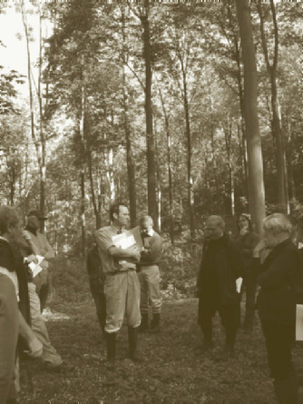 Graham Taylor (centre), Chairman of the Ash group, explaining the management of a stand of Ash and Sycamore at Settrington