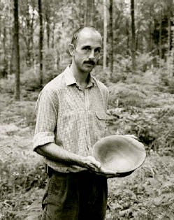 Neil Humphris shows off his elm bowl (turned by Richard Chapman) which was presented to him by the Trustees of Woodland Heritage
