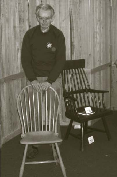 American Windsor maker Dave Sawyer with his delicate bow back side chair in a blue milk paint finish