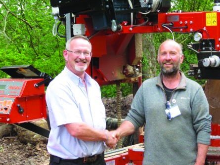 David Biggs (left) congratulating David Brown (right) on his Wood-Mizer bursary