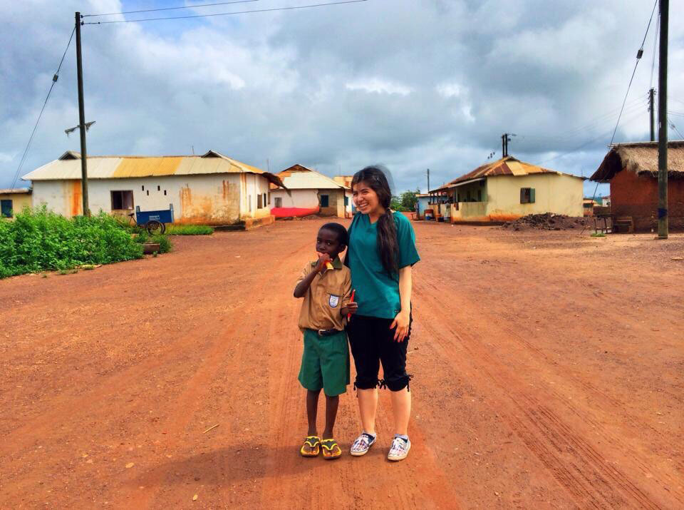 teen volunteer with kid in africa missionary ministry travel