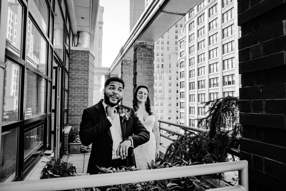 First look between Caitlin and Bryson at the Giraffe Hotel in Midtown Manhattan, New York, before their Wedding Ceremony. We got this impossible angle because we were on the balcony adjacent, so we were able to tell the story without getting in the way, doing our job as photojournalist wedding photographers
