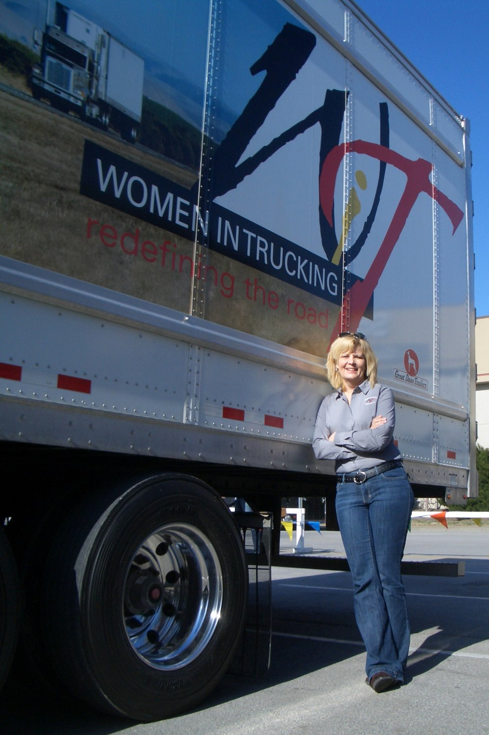 Ellen Voie, founder and CEO of the  Women In Trucking Association , shows off the WIT truck.