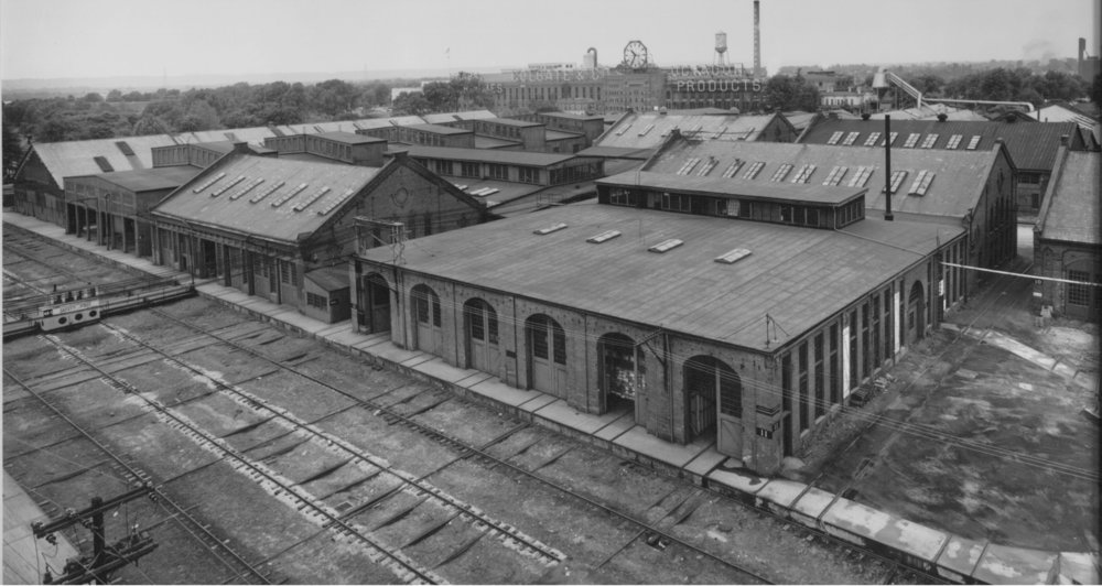 This photo was taken circa 1941 and shows the 400 building being used for storage during World War II.  The tracks in front of the building, which is now the Court Avenue extension, were one of the transfer pits where cars would be shuttled horizontally among the buildings.