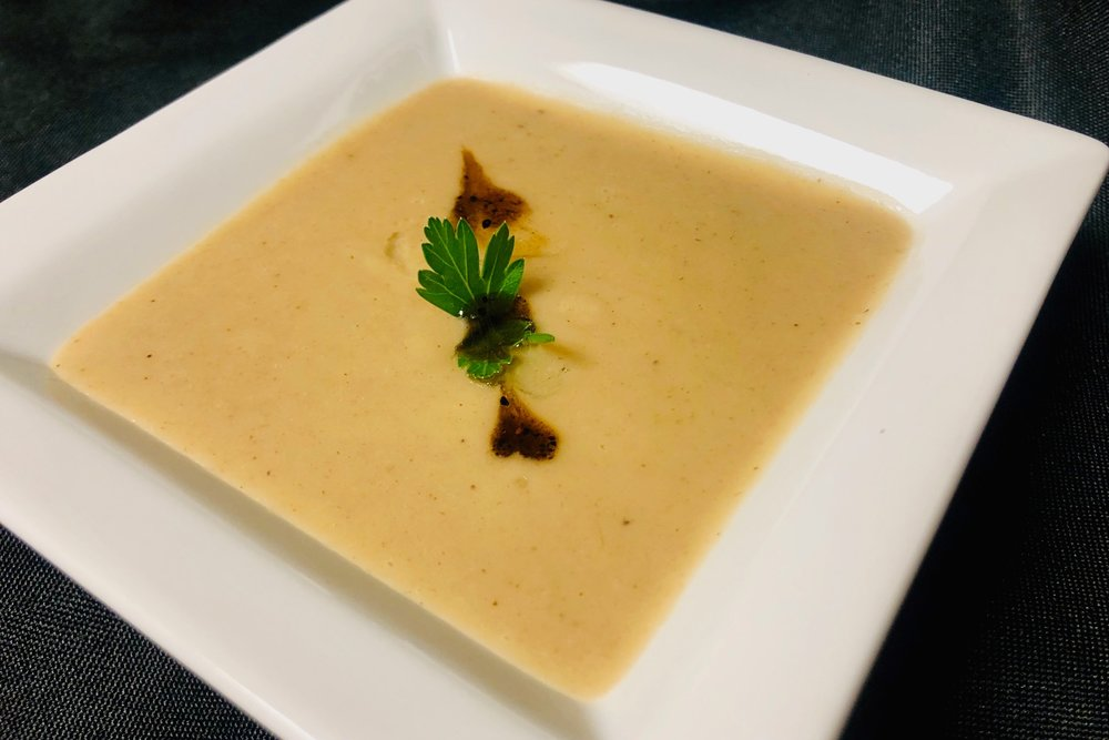 Truffle scented white bean soup with black garlic oil
