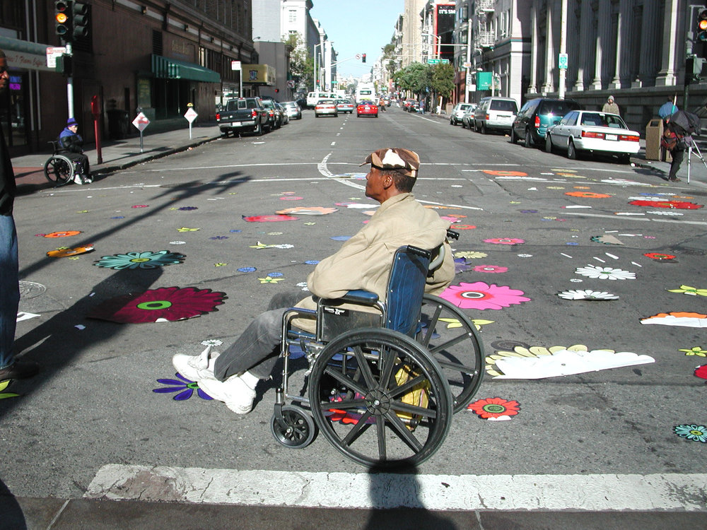 man in wheelchair in middle of intersection.jpg