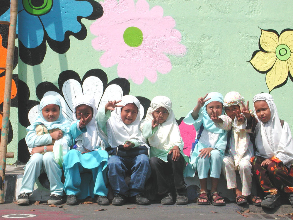 Megan -- girls in Muslim clothes in front of mural.jpg