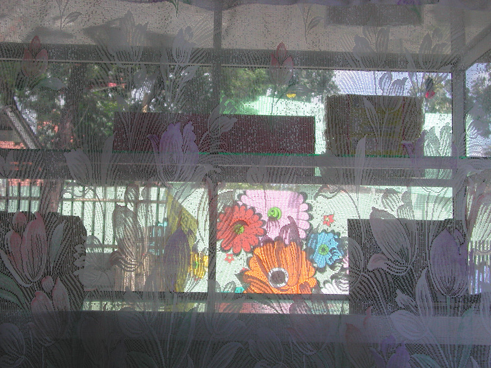 Megan -- looking at mural through warung curtain.jpg