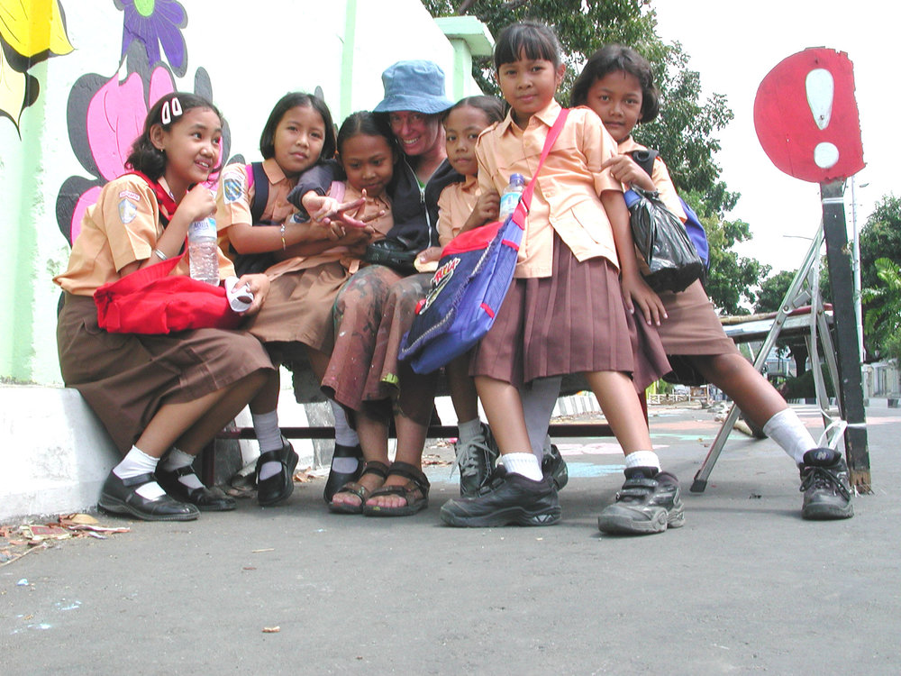 Megan -- sitting on bench with girls.jpg